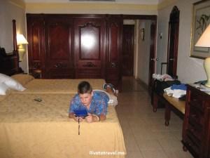 Rio resort, bedroom, kid playing video game, hotel, Dominican Republic, Riu resort, Punta Cana, Caribbean, travel