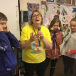 Headteacher serenades students for charity
