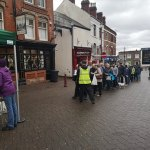 Apple tree queue in town centre.People are queuing down Bath Street for a free a…