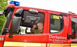 May be an image of 2 people, outdoors and text that says 'S CCTV 35 Fire & Rescue Service Derbyshire Making Derbyshire Safer to'