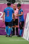Ilkeston referee Andy Page in action as Tokyo Games draw to a close....