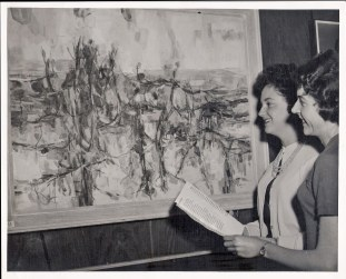 Helga (Christie) Burnett and Denise Atkins at Wollongong Art Competition; 19h October 1962; Guests admire winning painting, 'Wilson's Promontory Landscape' by Robert Grieve, at Wollongong Council Art Exhibition