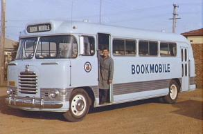 P11165 - Bookmobile driver Fred Hall on the steps of the Bookmobile.
