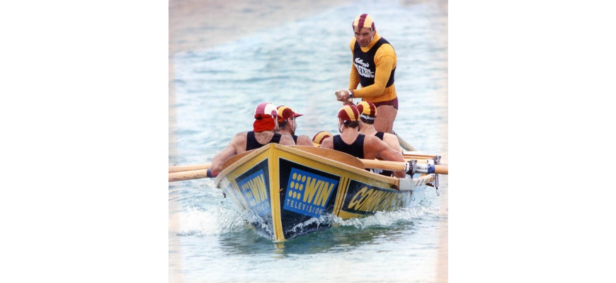 P27205 - Captain and sweep Robbie Meijer hard at work with his Bulli boat crew on their way to victory in the Surf Boat Spectacular at Manly Beach, 1991