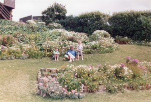 Carol with granddaughters Simone and Danielle in her garden - 1991
