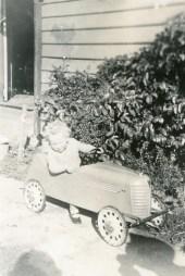 Barbara driving at an early age.