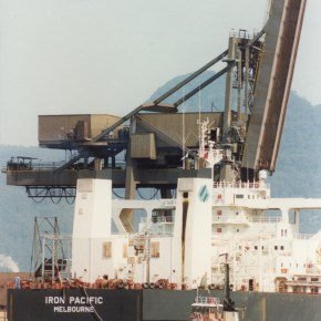 1993 - The Iron Pacific (ship) at the Iron Ore Loader with tugboat in the foreground, Port Kembla Harbour - from the Illawarra Mercury Collection - P26268