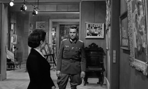 Paris museum docent Miss Villard (Suzanne Flon) finds German Colonel von Waldheim (Paul Scofield) before the works are loaded onto the train
