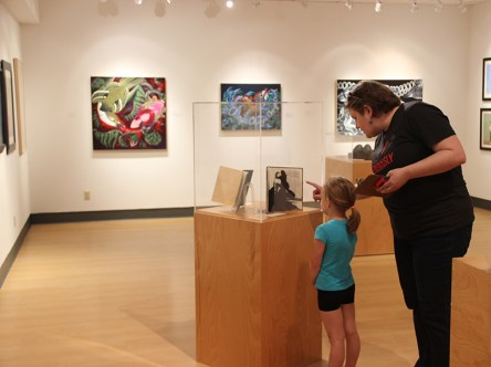 Visitors view art on display while completing a scavenger hunt.