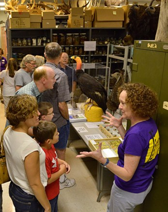 Dr. Meredith Mahoney talks with visitors in the Zoology collections range.