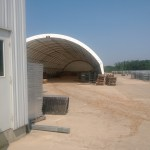 Storage for wood chips trucked in from across Illinois, including urban forest wood waste.