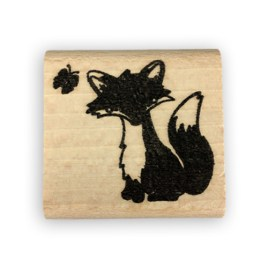 Foto stempel zittend vosje