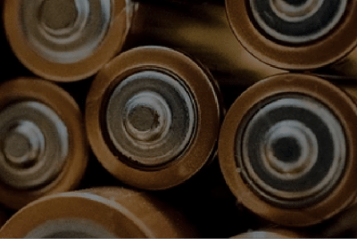 Batteries in a pile with a black overlay