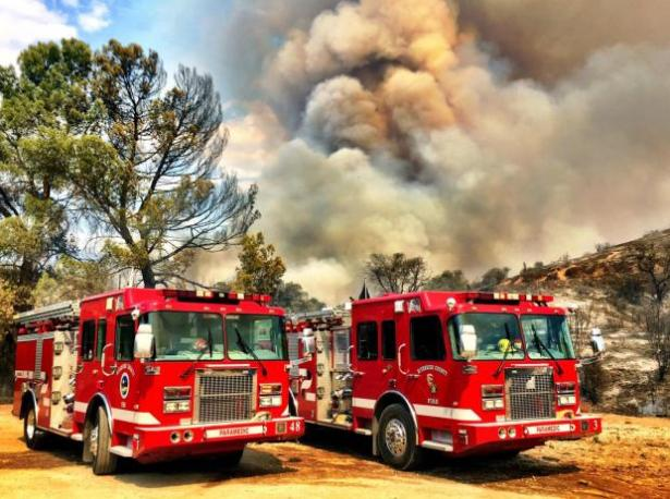 More than 300 firefighters rush to contain the fast-moving wildfire in southern California