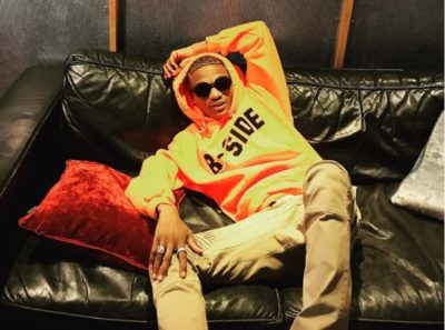 Watch Female Fan Trying To Give Wizkid A Blow Job On Stage