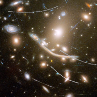 Asteroid Trails Streak Across This Deep-Space View of Thousands of Galaxies