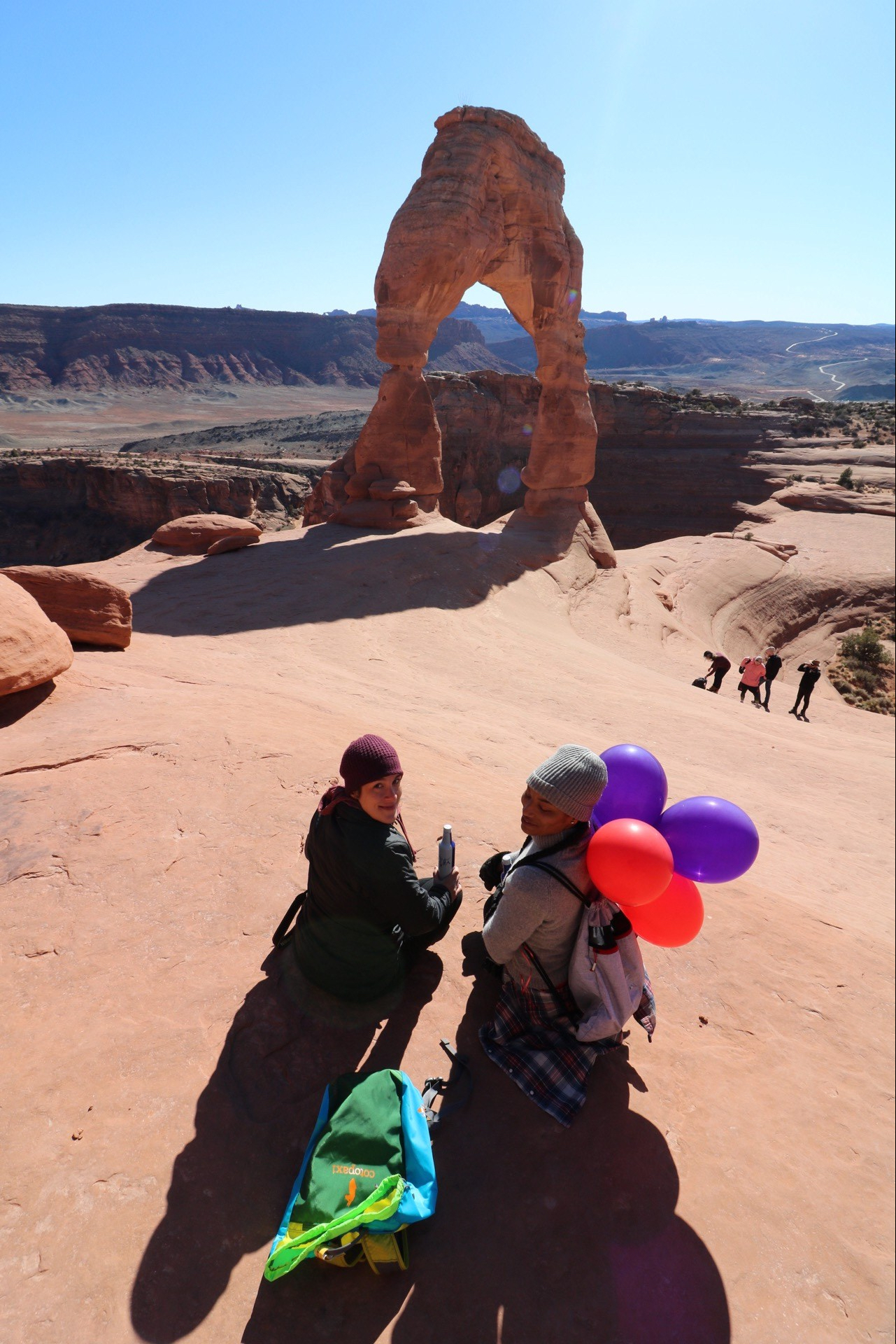 Illustrated by Sade - Having a cold beer in front of the Delicate Arch