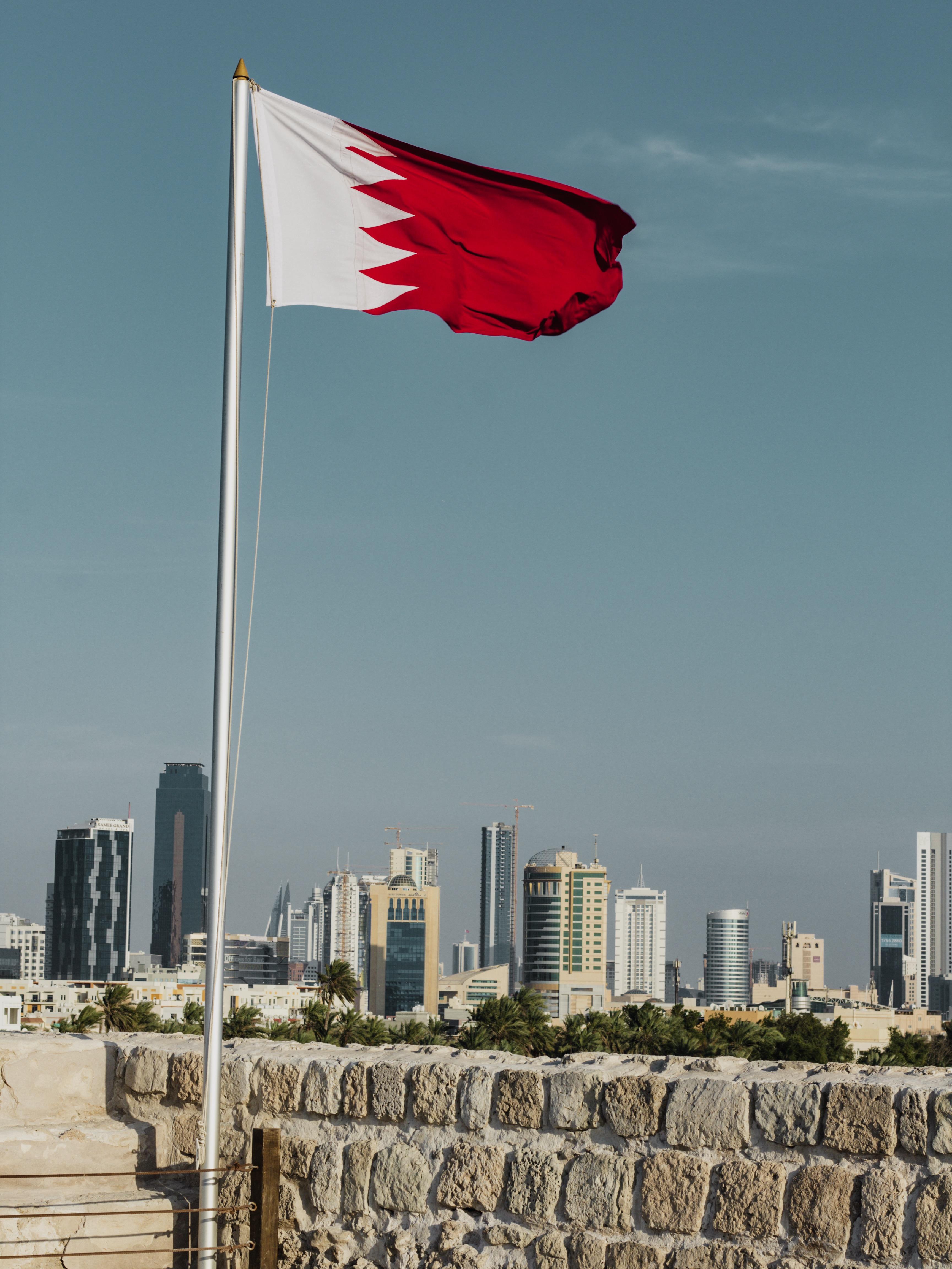 Illustrated by Sade - Bahrain flag and city skyline views