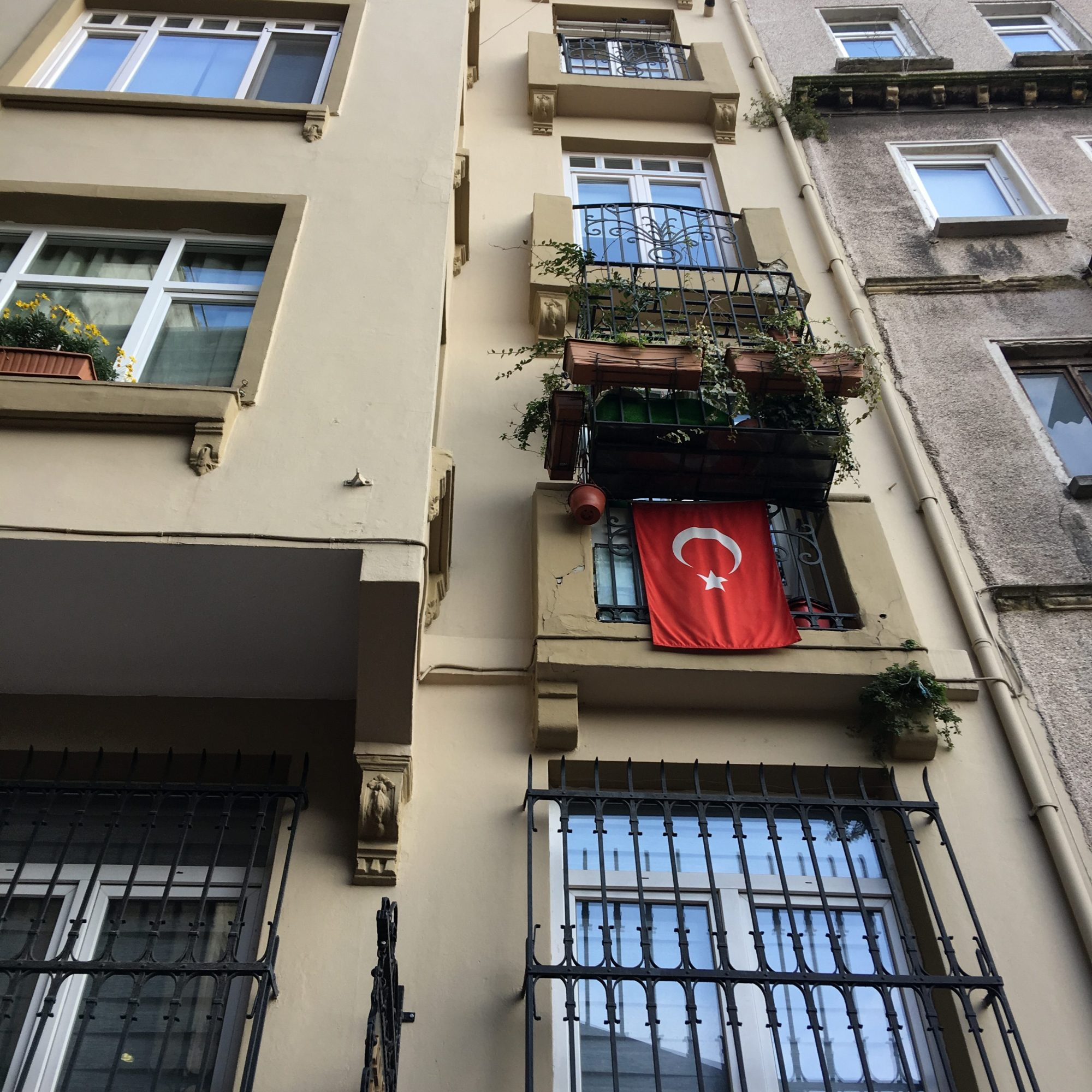 Illustrated by Sade - Turkish flag displayed on the balcony of a residential building in Istanbul