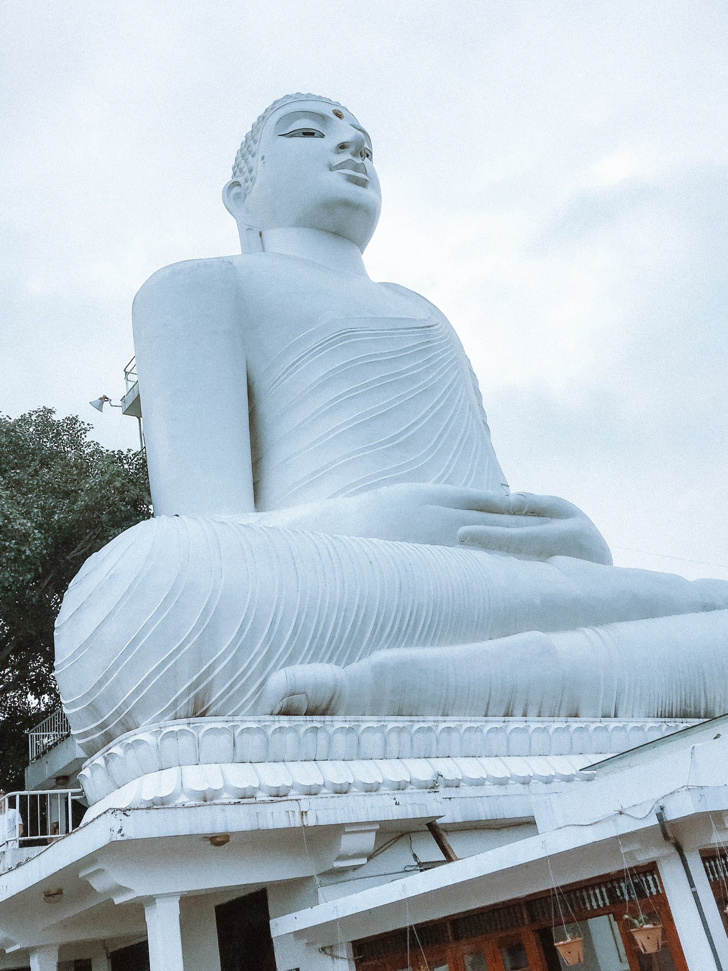 Illustrated by Sade - Buddha at Temple of Tooth in Kandy, Sri Lanka