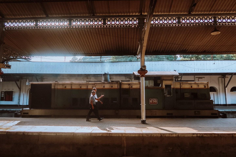 Illustrated by Sade - Pedestrians walking in Kandy Railway Station in Sri Lanka
