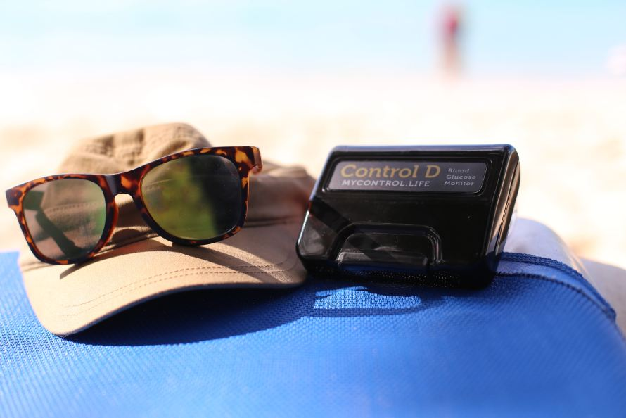 On the beach, travelling with Control D to test Blood Glucose levels when required. Handy to use device during travel.