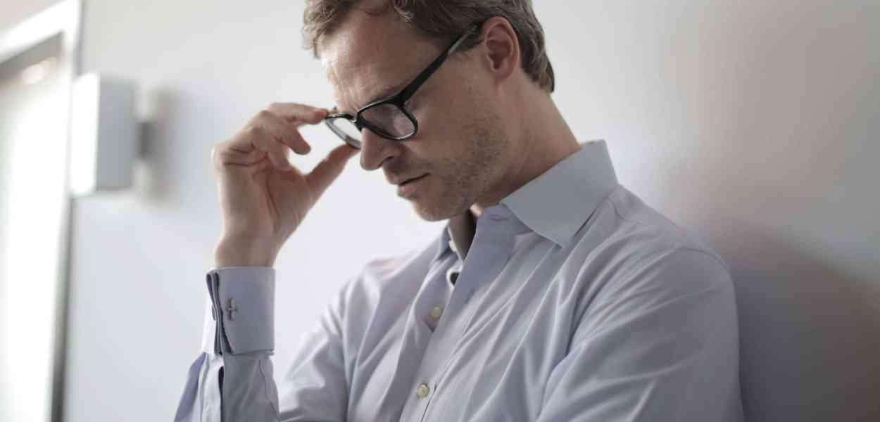 Photo of man wearing black eyeglasses
