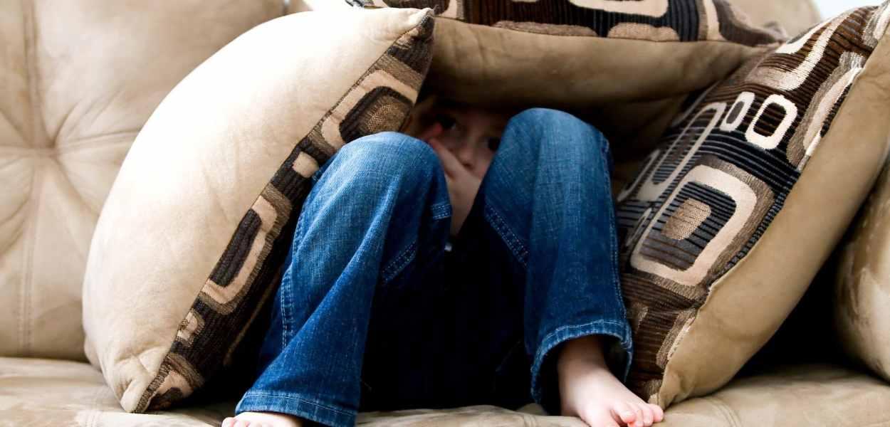 little boy, hiding, sad