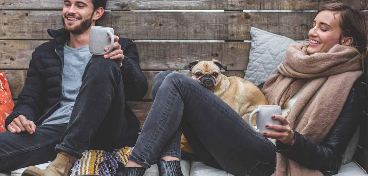man, woman, dog