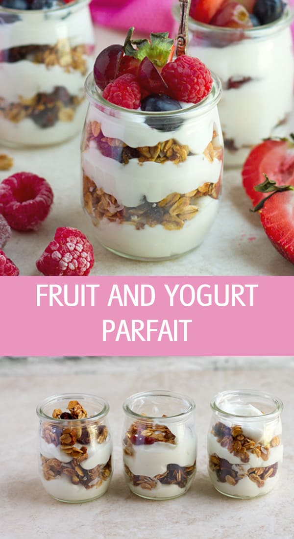 Fruit and yogurt parfait with frozen grapes, granola and berries.