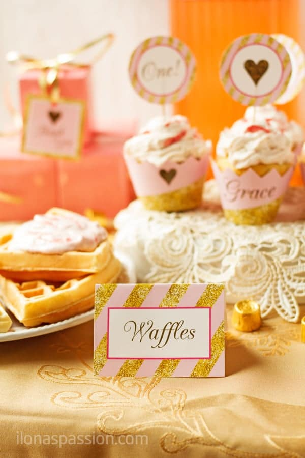 Waffles served for baby girl 1st birthday party with table tent.