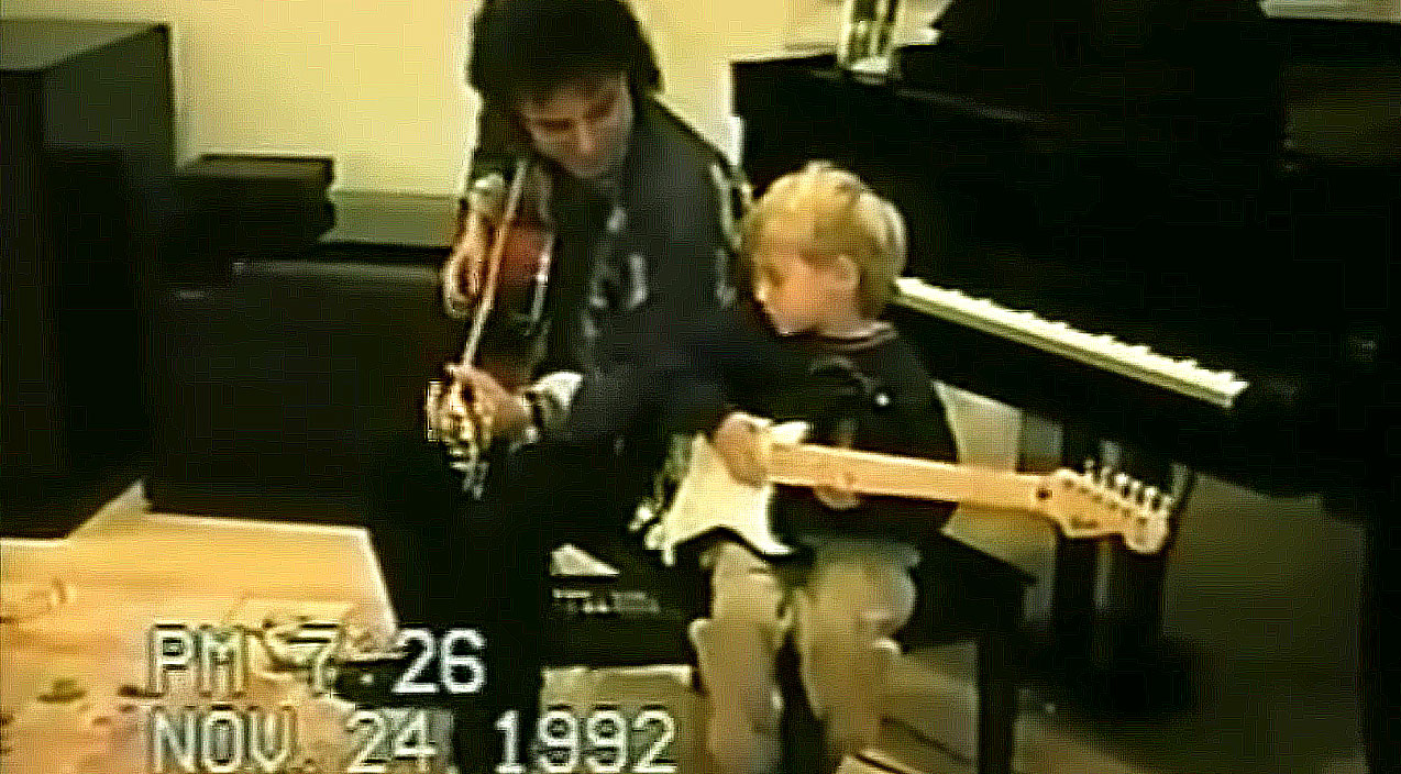 Home Video Of Neal Schon Giving Young Son Guitar Lesson