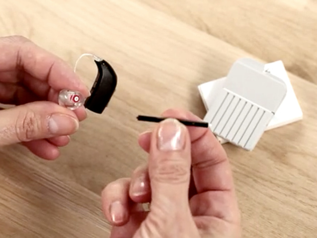 How do you clean hearing aids?