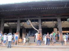 Inside Kiyomizudera. Very very simple interior, unlike some of the temples in China and cathedrals in Europe. It was drizzling by now - see the raindrops falling on the roof?