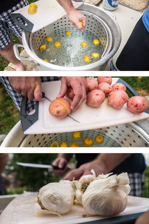 Hands add potatoes, lemons, and garlic to a large stock pot of water.