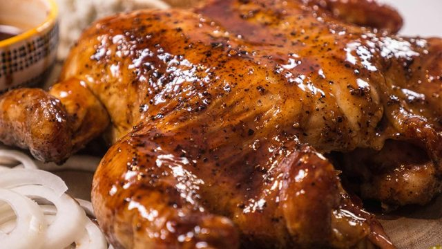 Crispy sauced skin of a whole smoked chicken.