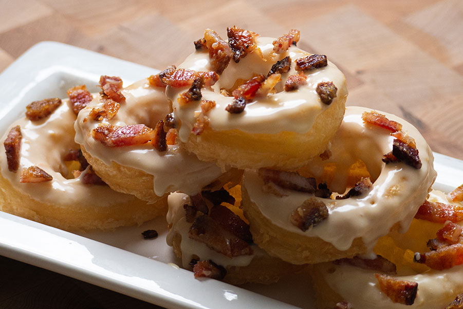 Tower of Maple Cronuts covered in candied bacon