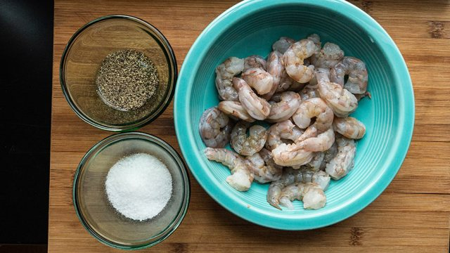 Bowl of shrimp with salt and pepper