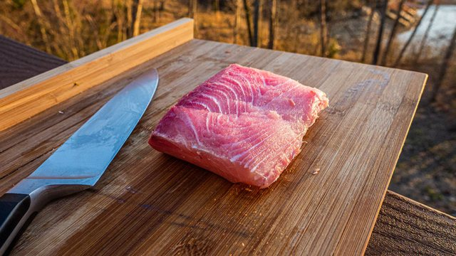Mahi fillet rests on a cutting board with a knife
