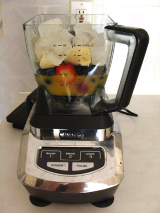 add a cup of blueberries and two bananas to the Ninja pitcher