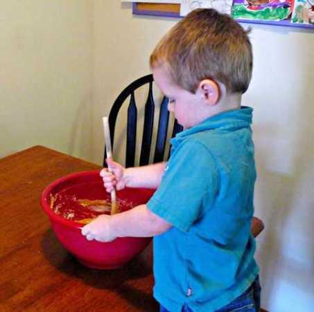 Hansome helper stirring playdough