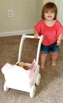Savannah Smiling and Pushing Doll Buggy