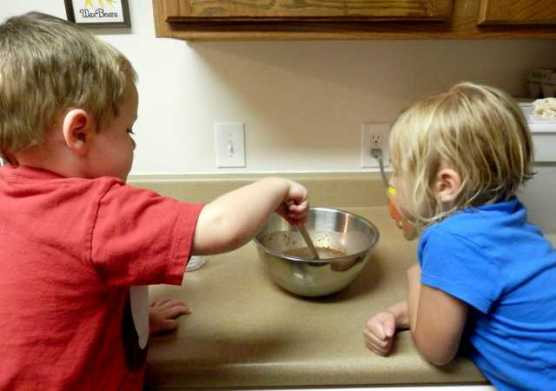 Kids stirring pudding