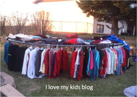 How to hang clothes at a yard sale use a trampoline.jpg