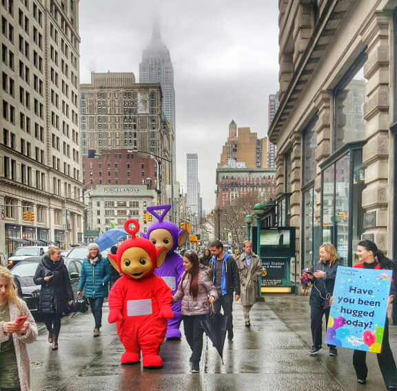 Teletubbies in haizy new york city, empire state building on the background