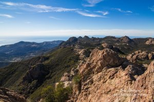 View looking west from Sandstone Peak. Two of the Channel Islands, Anacapa and Santa Cruz, can be seen in the distance.