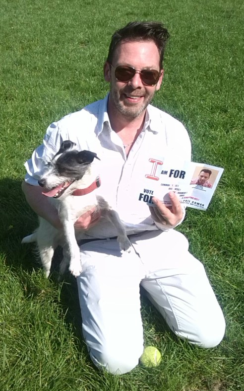Phil Cowan with his dog and election leaflet.