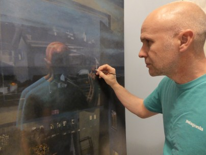 Ashley Hold working on his new painting, Nightview Reflections III