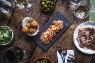 Beef ham Smoked sea trout with caper berries and quails egg Truffle arancini Mixed olives Courgette, rocket & parmesan salad Fried artichokes, aioli Potato and rosemary sourdough