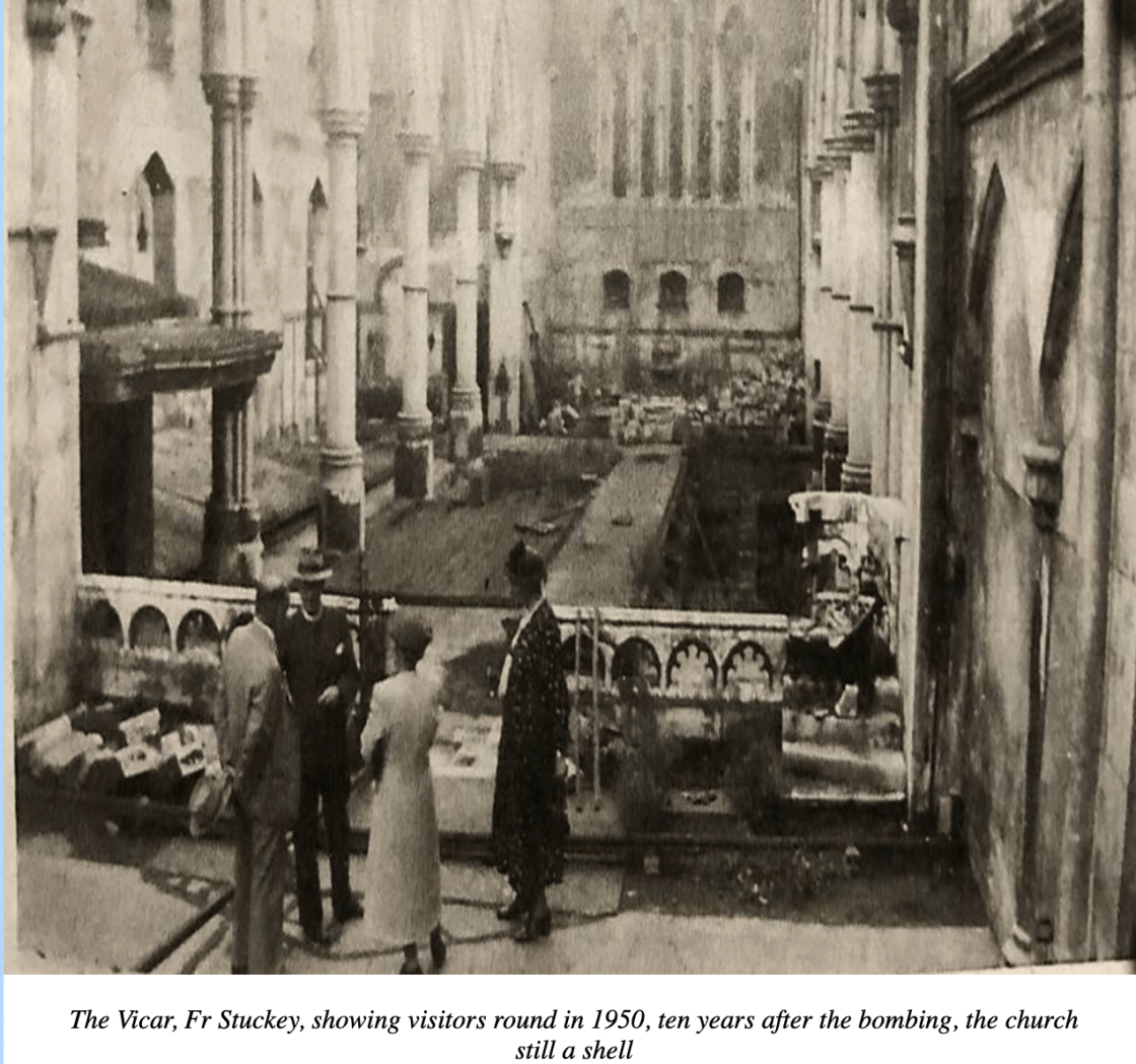 The Vicar, Fr Stuckey, showing visitors round in 1950, ten years after the bombing, the church still a shell